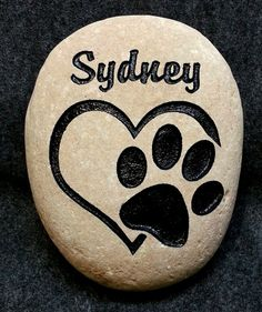 HEART/PAW DOG or CAT MEMORIAL MEMORY STONE, 8-10 or 6-7, Engraved & Personalized with Name. We sand Engrave & Paint in your choice of Black & Brown. Stones come in a variety of colors and shapes, so your stone will be a one of a kind unique shape and color. Your stone will last a lifetime in memory of your special Family. Name & Graphics will be place according to the shape of the rock at our discretion to make the best looking stone.