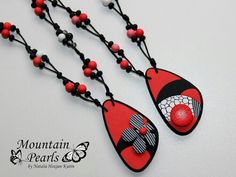 Love these graphic but organic polymer clay pendants