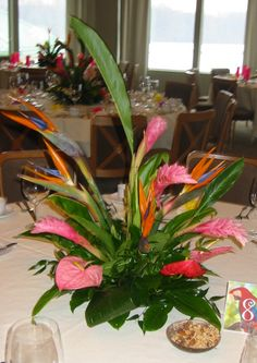 Hawaiian Luau Table Centerpiece | Choose linens in an assortment of bright colors - lime green, magenta ...