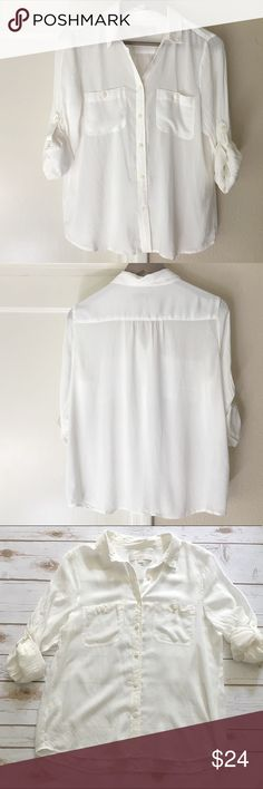 """Sheer White Button Down White button down. Petite Medium. Very lightweight - sheer. Loose, boxy fit. Two breast pockets with single button. Roll up long sleeves secured with button at elbows. Soft fabric. 100% Rayon. All measurements on one side when laid flat: Length about 23"""" from top of shoulder to hem. Underarm to underarm about 18.5"""". Hem about 21"""" wide. Worn gently a couple times - in excellent condition. LOFT Tops Button Down Shirts"""