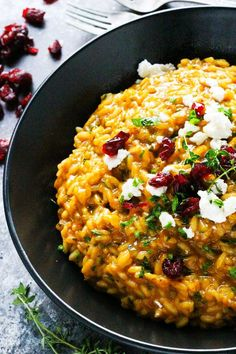 This Pumpkin Risotto with Goat Cheese & Dried Cranberries is a perfect fall comfort food - Rich, creamy and perfect for an elegant weeknight meal. Or try serving this to your vegetarian guests at Thanksgiving!   platingsandpairings.com More
