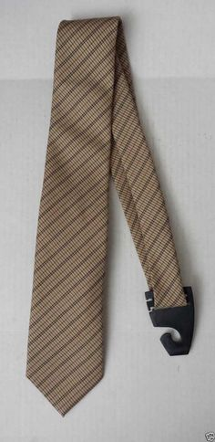 #men dress tie Moschino men neck silk dress tie faded gold color Made in Italy New with tags withing our EBAY store at  http://stores.ebay.com/esquirestore