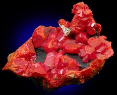 Realgar is an historically important mineral, with a striking ruby-red color that stands out in the mineral kingdom. The rare transparent lustrous forms are truly masterpieces in mineral aesthetics.