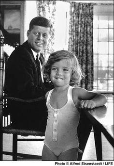 1960. John F. Kennedy and  his daughter, Caroline, at  home in Hyannisport,  Massachusetts