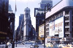 Looking west across Broadway at the southwest corner of 46th Street. Shown are: a full view of the large billboard atop The Victoria Theater for About Mrs. Leslie, a Dutch Masters Cigar