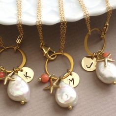 Bridesmaid Jewelry Gift Set - 3 Beach Bracelets - White Coin Pearl, Coral drop, Starfish Charm and Initial tag. $123.00, via Etsy.