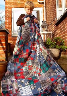 """5-year-old birthday quilt by Hanne Hector Schroeder (Denmark): """"I made a real man's quilt using second hand shirts and large enough for a bed cover"""""""