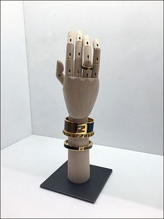 First glance this might seem like very a normal display, but just how does Fendi® keep the necklaces suspended and ring in place on the wooden artist's handform? CLICK through the gallery and conce...