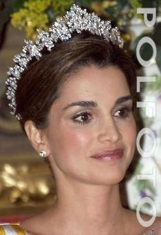 Alia's Diamond Tiara by Cartier, circa 20th century. The diamond Cartier tiara that Queen Alia wore was given to her by King Hussein. It's reminiscent of a fringe tiara, but really the design is quite abstract and very modern, more linear than floral. (The Jordanian royals seem to favor this kind of contemporary design; Queen Noor also has a tiara that is similar to this one.) The tiara is also intriguing in that it has an exceptionally tall base, requiring serious tiara hair.