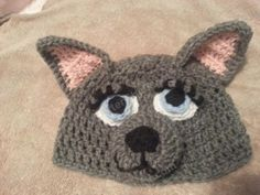Mother Wolf Crochet Beanie Hat Pattern Front View. Love the eyes