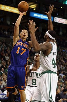 Jeremy Lin takes a shot as Chris Wilcox of the Celtics defends on March 4, 2012