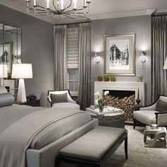 master bedroom layout. fireplace between windows round ottoman between two chairs mirrors behind night stands sconces on each side of the pict love it all