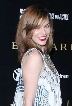Milla Jovovichs red hairstyle with bangs
