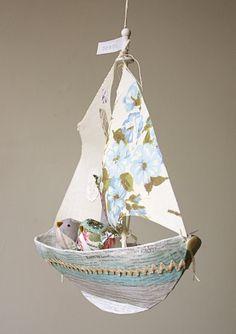 Paper mache' sail boats.