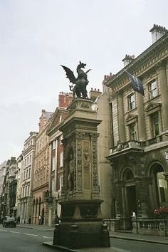 Horace Jones' Temple Bar marker topped by Charles Bell Birch's heraldic Dragon, Strand, London