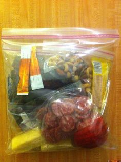 Hiking food - Pack each days food into a zip-lock bag in portion sizes. This will allow for you to keep one bag out for the entire day.