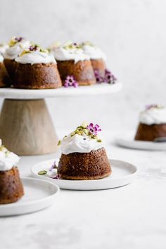 Flourless Lemon Pistachio Cakes with Honey Coconut Whipped Cream is the perfect refreshing spring dessert. These mini cakes boast nutty pistachios, fresh lemon, and are naturally sweetened with honey. Spring Desserts, Just Desserts, Mini Cakes, Cupcake Cakes, Cake Recipes, Dessert Recipes, Dessert Ideas, Pistachio Cake, Coconut Whipped Cream