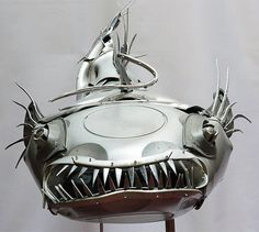 For over 12 years the artist Ptolemy Elrington recycles old hub caps Amazing Animal Sculpture .