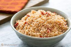 Spanish Rice Recipe Side Dishes with olive oil, onion, garlic cloves, long grain white rice, chicken stock, tomato paste, oregano, salt