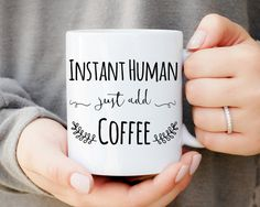 Instant Human, Just add coffee. This mug makes a great gift for co-workers, family members, friends and any other avid coffee drinker in your life! ------------------------------------------------------------------------------------------------ WHATS INCLUDED? -One 11 ounce ceramic mug (standard mug size) -Mug is made as shown in product image with handle on the right (made to hold in ring hand) -This mug is printed and pressed (NOT made using vinyl) -Dishwasher/Microwave safe -------...