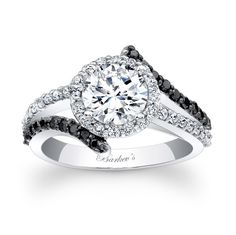 Black diamond halo ring. Ooooh, different! But, it would be too matchy-matchy with the wedding band that I want.