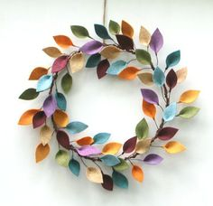 This beautiful wreath will add color and something unique to your decor. Wool-blend felt leaves in a variety of shades are individually attached to brown floral wire, then to a wreath base made from grapevine-covered wire. It is very lightweight and has a shallow profile, so it will fit into any space. The wreath measures approximately 14-16; if youd like a different size, please message me and Ill be happy to make one to suit your needs.  ***This wreath is made to order. Please allow 5-7…
