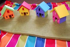 We also built houses out of colorful paper held together with pieces of velcro, so the girls could build their village over and over again. There's a free printable template so you can make your own too!