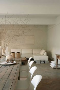 white on white, blanched sprigs in vase are beautiful on wood table