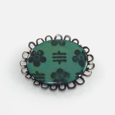 Enamel brooch, small green with flowers by Alice Whish. www.stanleystreetgallery.com.au  One of my favourite jewels I love wearing this piece. Thanks for pinning my works Stanley Street Gallery. Enamel Jewelry, Jewelry Art, Jewellery, Street Gallery, Diamond Are A Girls Best Friend, Wearable Art, Alice, Brooch, Jewels