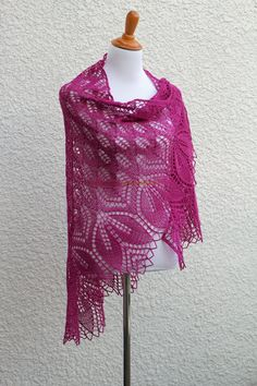 This knit shawl is made with a 100% wool in fuchsia color. Perfect #gift for her!It is very laced and delicate and yet warm an cozy.Simple flower ornament adds a romantic lo... #kgthreads #accessories #elegant #fashion #handknit #knitting #lace