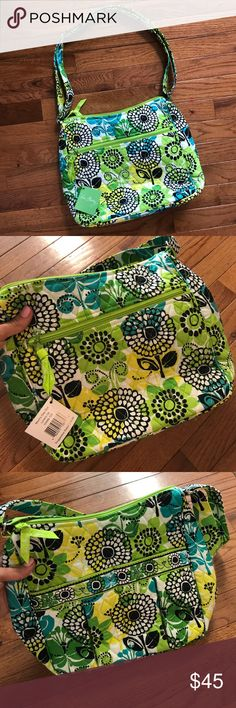 Brand New Green VERA BRADLEY Purse This brand-new vera Bradley purse is super cute and perfect for summer! It is in perfect condition and still has the tags on it. On one side it has an outside zipper pocket and on the other side it has two outside pockets. Two pockets on the inside as well. The strap is adjustable. 💚💚💚💚💚💚💚💚💚 Vera Bradley Bags Shoulder Bags