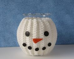 Snowman Jar Cozy  Materials: Red Heart Worsted Weight Acrylic Yarn  - Soft White Assorted buttons for eyes, nose and mouth (Red Heart's des...
