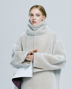 ANDREA JIAPEI LI AW15 via skt4ng.com | The sports mesh bonded onto a a heavy weight fabric produces great silhouette and form- as well as creating interesting shadows that enhance the garment