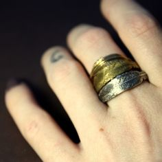 $54 set of mixed metal feather rings
