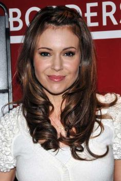 Alyssa Milanos long layered hairstyle -- Love the hair color