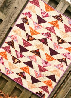 Quilt Story:  Modern baby girl quilt with flying geese.  Awesome modern layout alternating rows.  Eggplant, peach, pink, burnt orange and lilac. Most fabrics are from Outfoxed by Lizzy House.  Measurements given in the blog post. Quilt is in the shop! :)