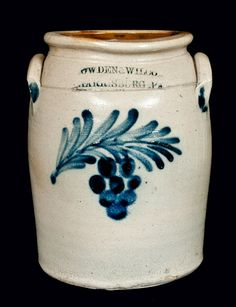 "Price Realized: $ 1,265.00 One-Gallon Stoneware Jar with Cobalt Grapes Decoration, Stamped ""COWDEN & WILCOX / HARRISBURG, PA,"" circa 1865, cylindrical jar with sloped shoulder, rounded rim, and applied lug handles, decorated with a cluster of grapes hanging from a a leafy branch. Desirable small size. Provenance: Lynn White Collection, Readfield, ME. Small stone ping to shoulder on front. 1 3/4"" hairline from rim on reverse. Small rim chip. Minor wear to"