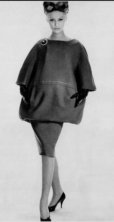 1960 Diana Nixon in green wool two-piece with extreme blouson top by (YSL) Christian Dior