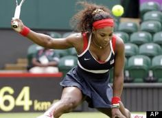 WIMBLEDON, England -- Serena Williams advanced to the second round at the Olympics on Saturday on the same Wimbledon court where she won her 14th Grand Slam title a few weeks ago.    U.S. First Lady Michelle Obama watched from the front row of Williams' box as the fourth-seeded American beat former No. 1 Jelena Jankovic of Serbia 6-3, 6-1 on Centre Court
