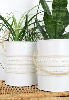 Fresh paint and a textured trim upcycle coffee tins into decorative planters.