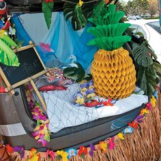 Luau Trunk or Treat Car Decorations | Turn up the heat on Halloween fun with this tropical trunk or treat scene! It's a breeze to create - click here to learn how! #trunkortreat