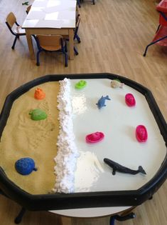 cous cous sandy beach with shaving foam waves and cornflour sea