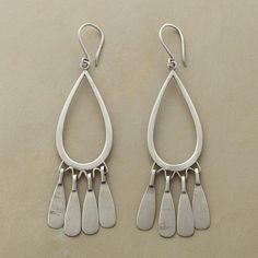 "ELEMENTAL EARRINGS -- Artist Jane Diaz mixes metaphors, ancient and modern, to great effect in these striking brushed sterling silver earrings. Approx. 3""L."