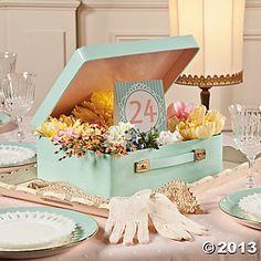 Centro de mesa con maleta en color menta