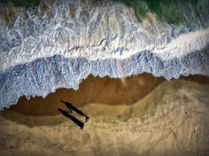 A couple walking on the beach in Montauk, New York, is seen from above in this National Geographic Photo of the Day.