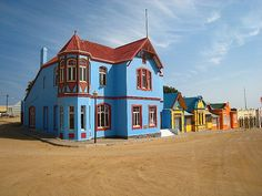 Lüderitz  (Namibia). 'Namibia is a country  that defies African  stereotypes and this is  perhaps nowhere more true  than in the historic colonial  town of Lüderitz.  This bizarre  mini-Deutschland is seemingly  stuck in a time warp.' http://www.lonelyplanet.com/namibia/southern-namibia/luderitz