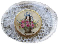 Hand Painting Victorian Roses and Flower basket painted on Vintage Mother of Pearl Button via Etsy.