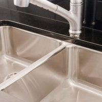 Despite the name, stainless steel sinks do get stained and dirty. As dishes get piled in the sink and liquids such as coffee get poured into it, it can take on a dirty and dingy look. You shouldn't use bleach or abrasive cleaners on the stainless steel, but a simple household ingredient can easily bring back the shine.