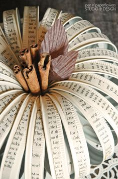 Stunning fall centerpiece using Mason Jar lids and old book pages. So beautiful.