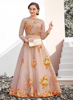 You are bound to make a powerful fashion statement with this demure beige satin silk designer gown. The wonderful attire creates a dramatic canvas with wonderful embroidered and resham work. Silk Lehenga, Silk Sarees, Anarkali, Western Gown Design, Indian Gowns, Ethnic Dress, Fashion Sale, Designer Gowns, Embroidered Silk